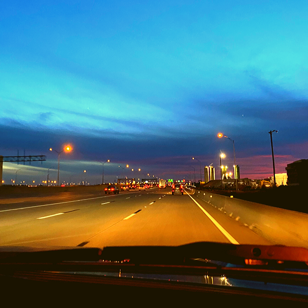 dashboard view of highway at sunset in Grapevine Texas